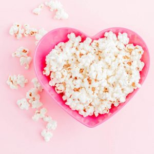 bowl of popcorn in a pink heart bowl for post on musical themed parties