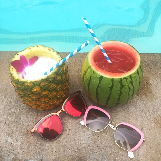 cocktails served in a watermelon cocktails served in a pineapple