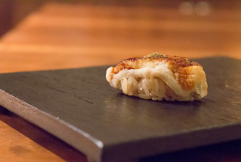 Sea eel sushi torched with flame