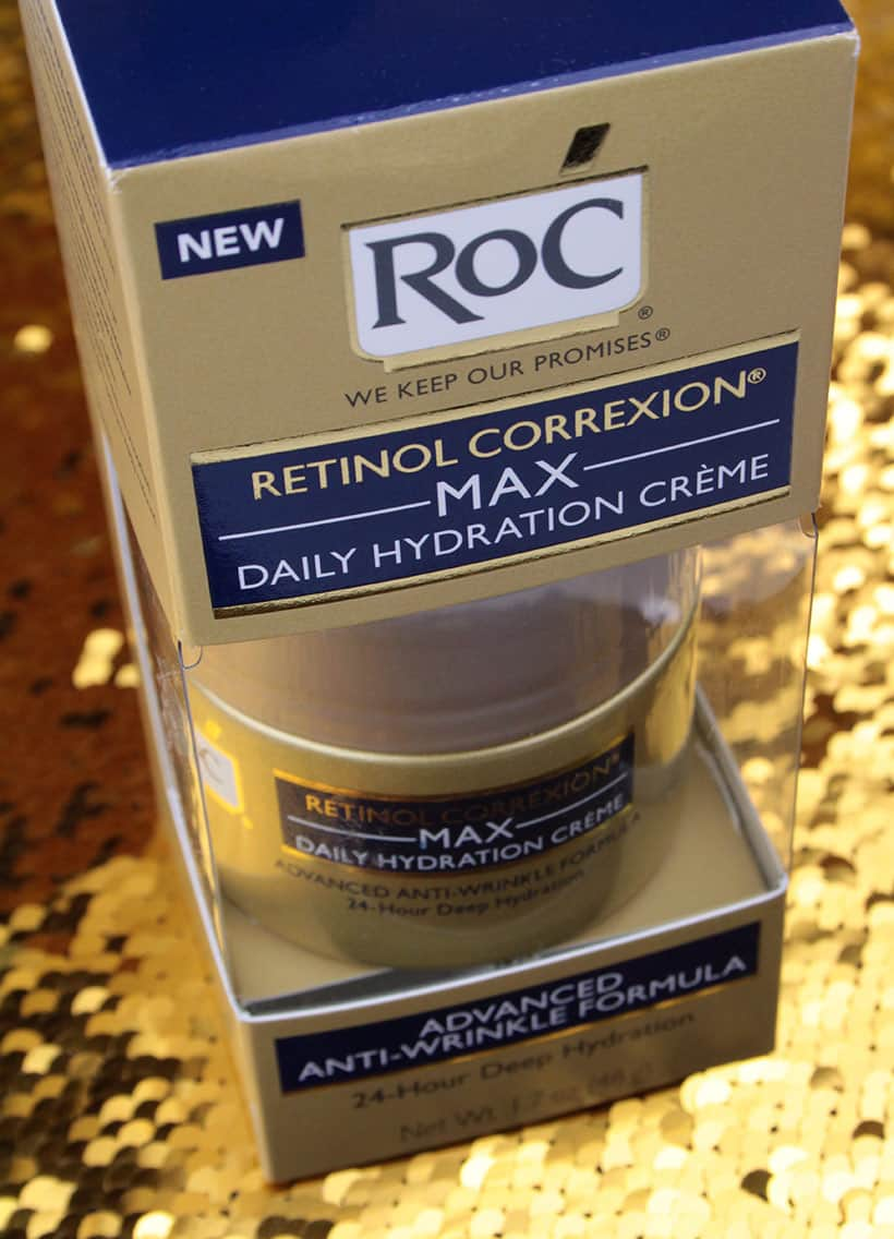 Roc drugstore moisturizer on gold glitter background
