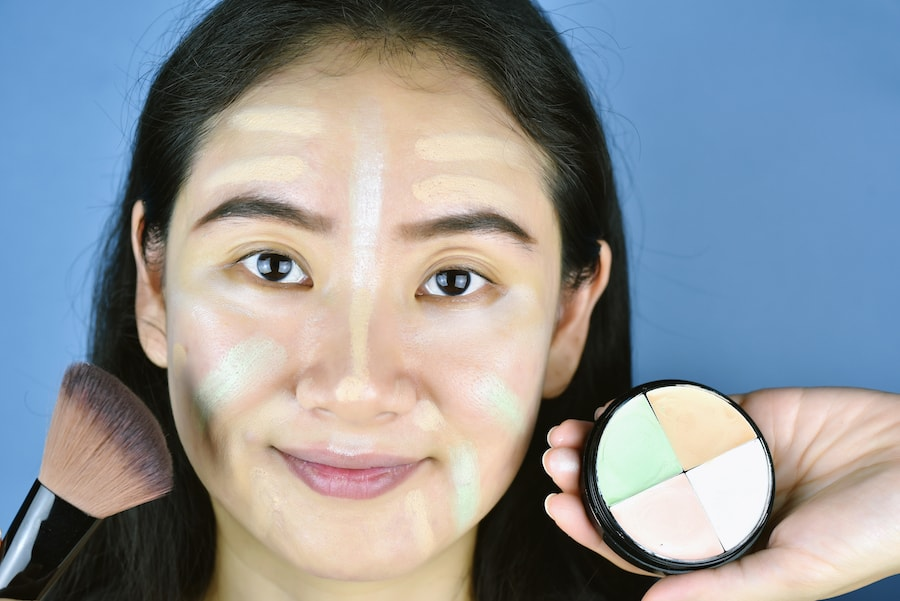 woman with different color correcting concealers on her face