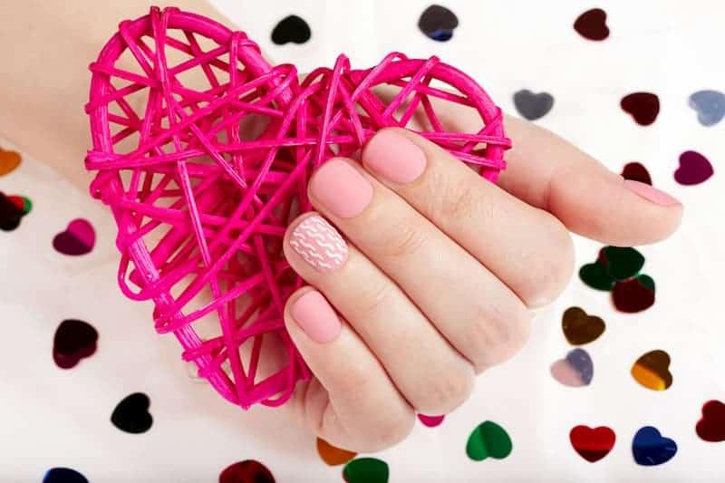 woman with pink matte nail polish