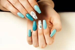 Coffin nail design ideas: long turquoise coffin nails