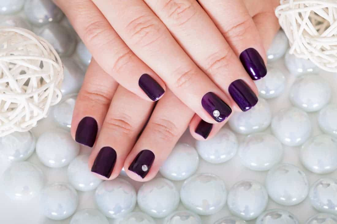 Woman with beautiful nails. Example in dip nails system review.