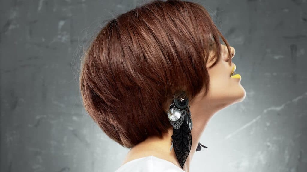 Woman with brown short stacked bob hairstyle