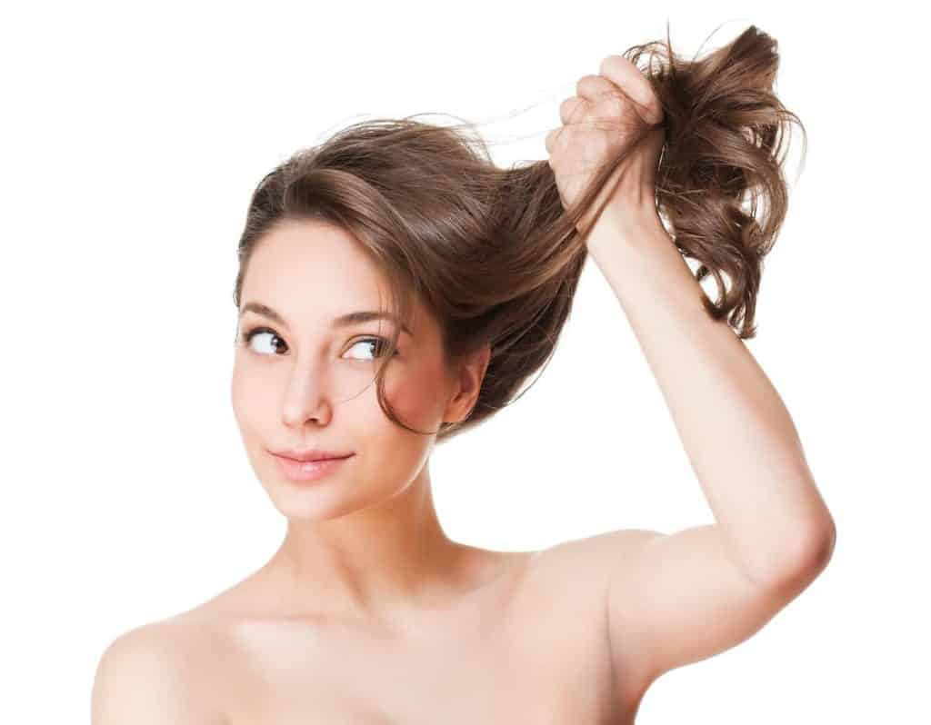 woman with brown hair showing the strength of keratin treatment products