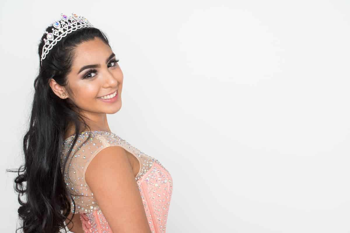 Latina girl with a beautiful half up Quinceañera hairstyle